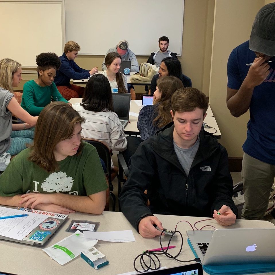 Students build an arduino in class