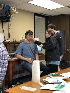 Students performing brain scans